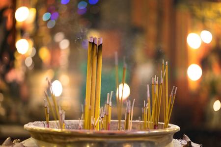 Man Mo temple - Hong Kong , Incense burning at the famous temple Man Mo with Bokeh background. Stock Photo