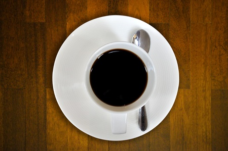Cup of coffee on the old brown wooden photo