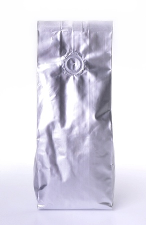 Aluminum foil package isolates on white background. photo