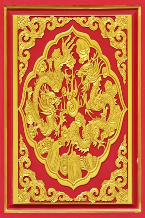 chinese style goden dragon on the red wood door. photo