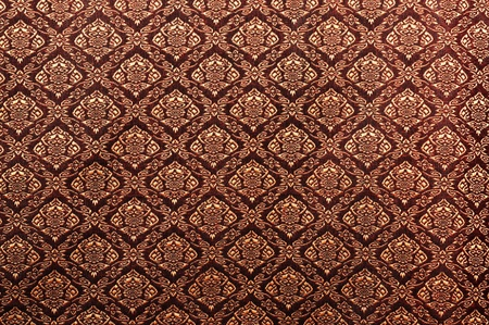 thai silk: Thai painting pattern of golden brown silk cloth full frame.