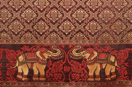 thailand fabrics: Elephant pattern background and thai painting pattern of thai silk. Stock Photo