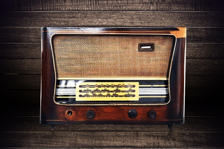 Old fashioned radio on old background. Stock Photo