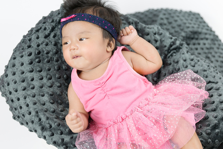 asian baby girl in pink dress Stock Photo