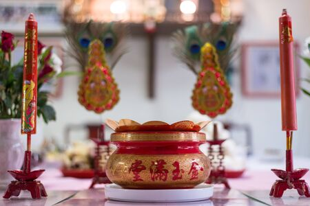 ancestor: A table feast  and prop on chinese newyear to respect the ancestor and celebrate the new year to come.