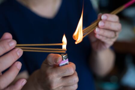 flicker: A flame flicker on the the incense to pay respect to the chinese ancestor. To celebrate chinese new year.Faithfully and respectfully Stock Photo