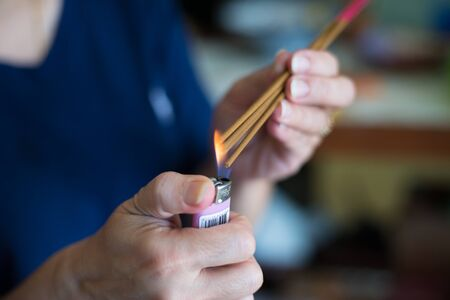 ancestor: A flame flicker on the the incense to pay respect to the chinese ancestor. To celebrate chinese new year.Faithfully and respectfully Stock Photo
