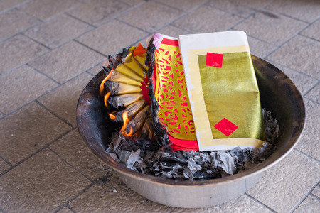 ancestor: A ritual to burn the golden paper to the ancestor to pay respect and celebrate chinese new year. Faithfully and respectfully