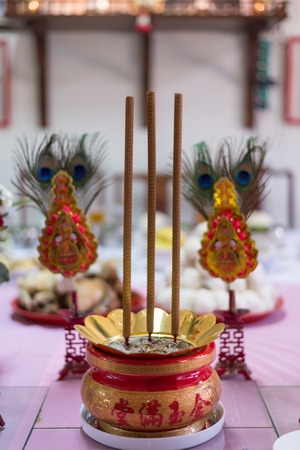 chinese alphabet: A bucket of incense marked with chinese alphabet represent prosperity. the ritual was made in ancestor day and chinese new year.