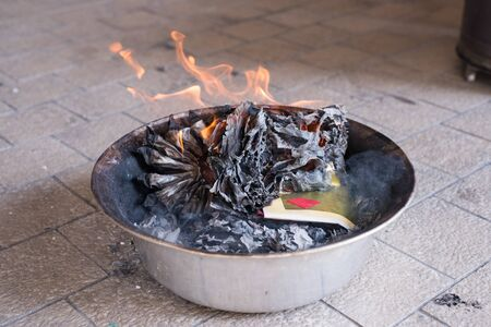 ancestor: A burning golden paper. A chinese ritual to pay respect to the ancestor, believing that the prosper will be sent to the their gone beloved