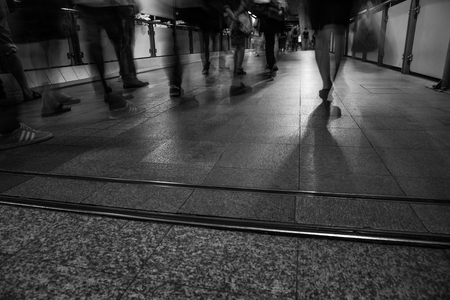 careless: A rush hour in the metro. Picture was taken in black and white with long exposure to represent the confusion in the city. Rush and careless .