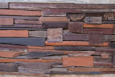 Wall made  by pieces of woods. Patched, nailed and stick up on the wall to make different texture. Vintage