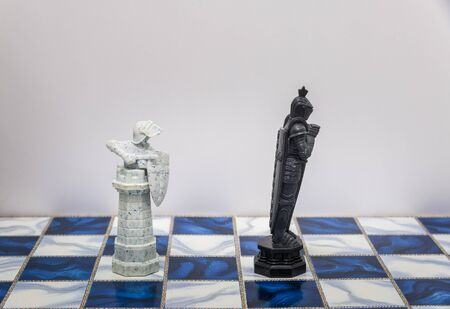 dueling: A pieces of chess character on the board with a light. A character represents strategy, planning, brave, betrayal, confrontation and competition.