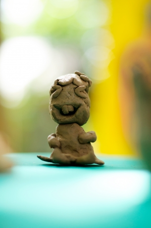 Smiley clay doll photo