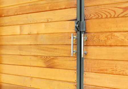 view of a wooden doorway: The door handle. A wooden door Stock Photo