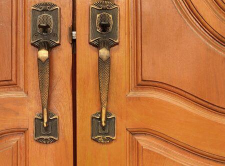 wood door: Old brass handle on wood door. Stock Photo