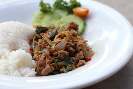 Thai spicy food basil pork fried rice recipe (Phat Kra Pow Moo) Stock Photo