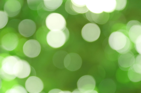 Green bokeh, abstract blurred background from nature forest. Stock Photo