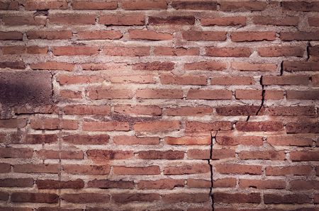 Old grungy texture, red brick wall with vintage style pattern for background and design art work.