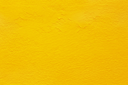 Yellow concrete cement wall texture for background and design art work.
