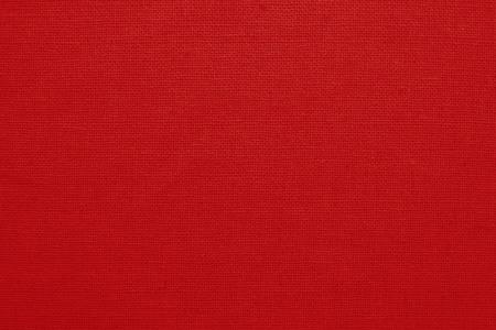 Fondo de textura de tela de algodón rojo, patrón sin costuras de textil natural.