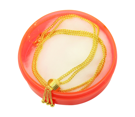Gold chain necklace isolated on white background with clipping path.