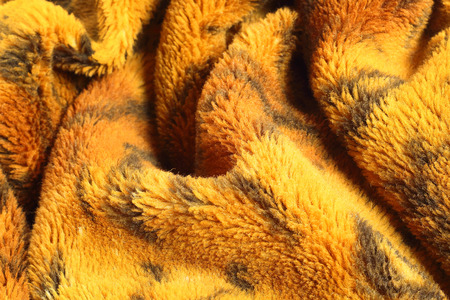 Close up of blanket in tiger pattern texture background.