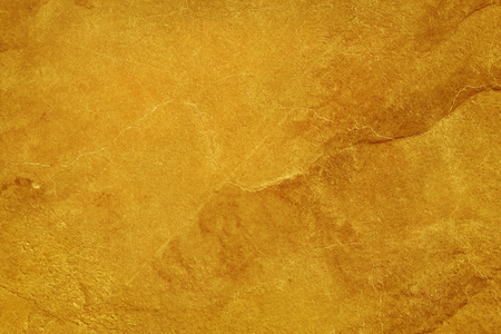 golden color cement concrete wall texture background, detail of rough stucco and old grunge abstract for design art work.