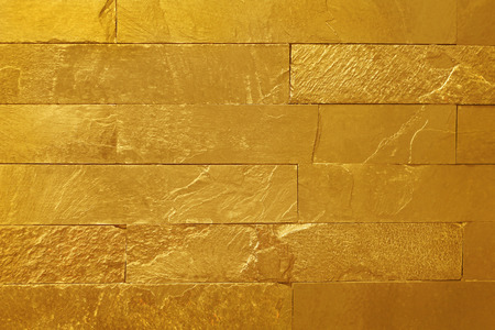 golden slate stone wall texture in natural pattern with high resolution for background and design art work.