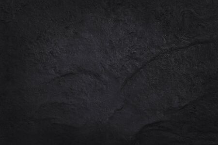 Dark grey black slate texture in natural pattern with high resolution for background and design art work. Black stone wall. Stock Photo