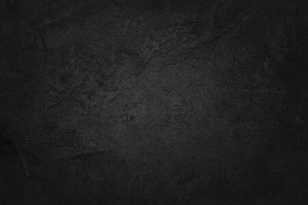Trama di ardesia nera grigio scuro ad alta risoluzione, sfondo di muro di pietra nera naturale.
