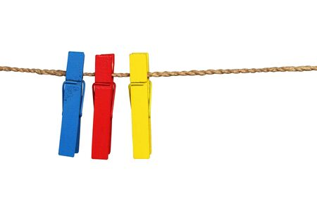 Collection of colorful wooden clothes pin and clothes line rope isolated on white background with clipping path.