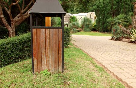Close up of recycled wooden trash bin in the public park.