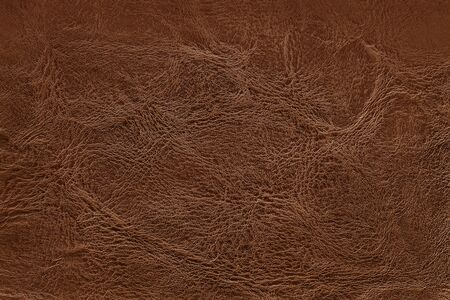 Dark brown leather texture background with seamless pattern and high resolution.