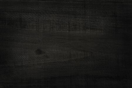 Black wooden wall background, texture of dark bark wood with old natural pattern for design art work, top view of grain timber. Stock Photo