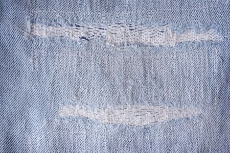 Pattern of tear and old on denim trousers, detail jeans texture for background.