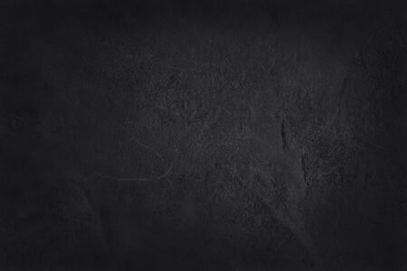 Dark grey black slate texture with high resolution, background of natural black stone wall. Stock Photo