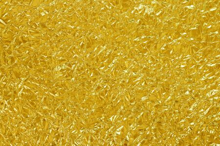 Gold foil leaf shiny texture, abstract yellow wrapping paper for background and design art work. Reklamní fotografie