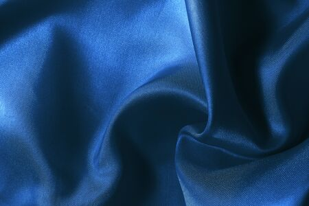 Dark blue fabric cloth texture for background and design art work, beautiful pattern of silk or linen.