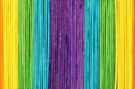Colorful wooden wall texture background in bright rainbow colors pattern.