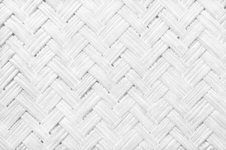 White grey bamboo weaving pattern, old woven rattan wall texture for background and design art work. 版權商用圖片