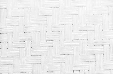 White grey bamboo weaving pattern, old woven rattan wall texture for background and design art work. 免版税图像