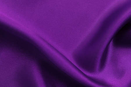 Purple fabric cloth texture for background and design art work, beautiful crumpled pattern of silk or linen. 免版税图像