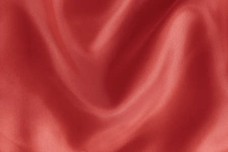 Rose gold fabric cloth texture for background and design art work, beautiful crumpled pattern of silk or linen. 免版税图像