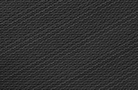 Black rubber texture background with seamless pattern. Imagens