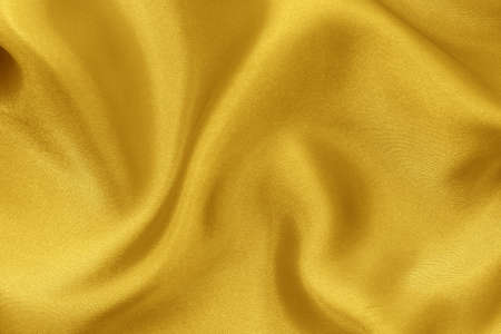 Golden yellow fabric cloth texture for background and design art work, beautiful crumpled pattern of silk or linen. Imagens