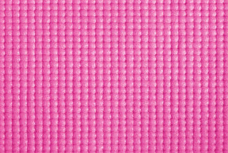 Texture of pink color yoga mat for background and design art work.