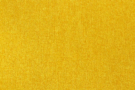 Yellow fabric texture background, seamless pattern of natural textile surface.