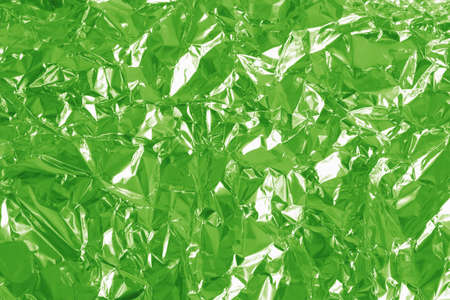 Light green foil shiny texture, abstract wrapping paper for background and design art work. Imagens