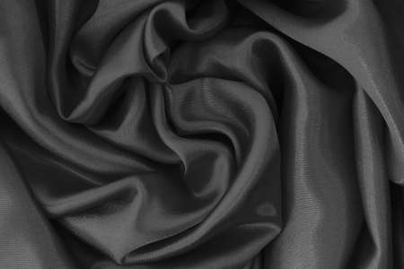Dark grey fabric cloth texture for background and design art work, beautiful crumpled pattern of silk or linen.